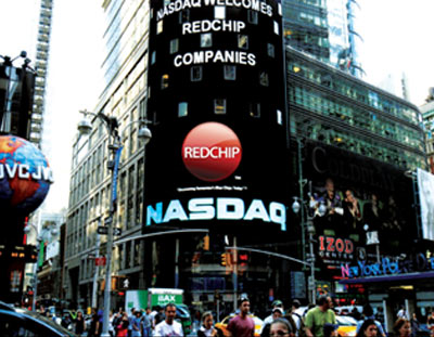 RedChip NASDAQ on the screen at side of building