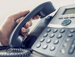 IP Telephone Multi function. a man hand that is picking up the phone.